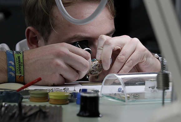A worker checks a watch by German watchmaker A Lange & Soehne in Glashuette, Germany.