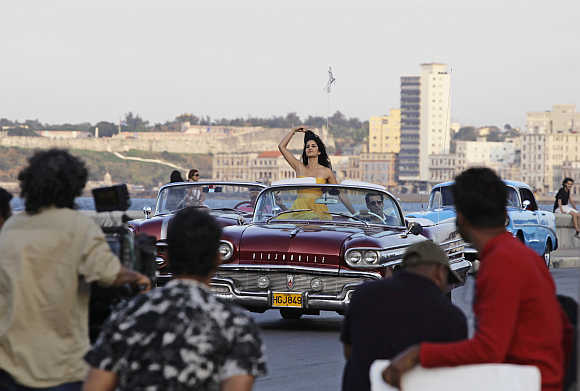 A camera crew films Salman Khan and Katrina Kaif in a convertible car on Havana's seafront boulevard El Malecon in Cuba.