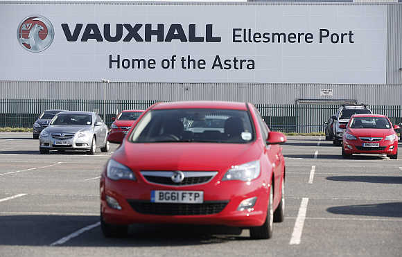 Vauxhall cars in a car park outside the company's plant in Ellesmere Port, northern England.