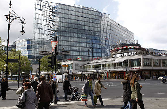 People walk on the Kurfuerstendamm boulevard in Berlin.