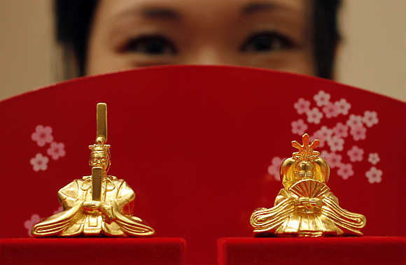 Japanese ornamental 'hina' dolls, made of pure gold, is unveiled at the Ginza Tanaka store in Tokyo.