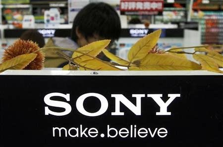 A man stands behind Sony Corp's logo at an electronics store in Tokyo.
