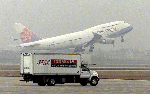 Taiwan's China Airlines plane takes off at Pudong International Airport in Shanghai.
