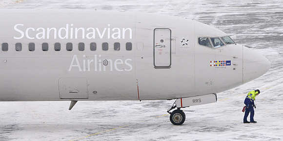 A SAS Boeing 737 plane at Terminal 5 at Arlanda Airport, north of Stockholm.