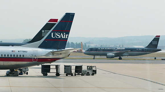 US Airways plane taxies the runway at the Washington Ronald Reagan National Airport in Washington, DC.