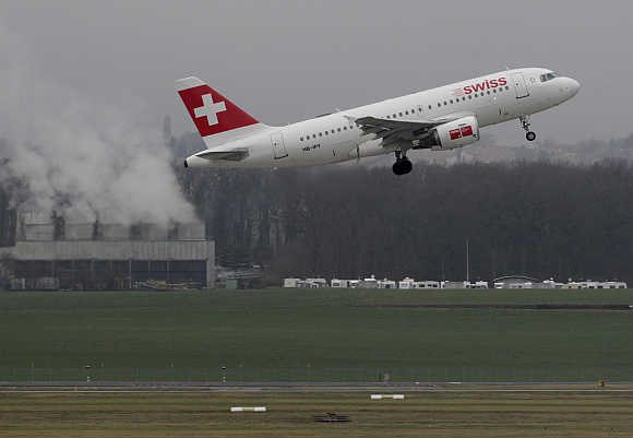 A Swiss airlines plane takes off at Cointrin airport in Geneva, Swizerland.