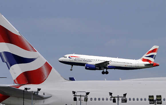 A British Airways plane lands at Heathrow Airport in west London.