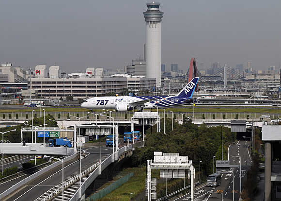 A Boeing 787 Dreamliner aircraft taxis after landing for delivery to All Nippon Airways of Japan at Haneda airport in Tokyo.