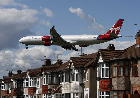 A Virgin Atlantic airline aircraft comes in to land at Heathrow Airport in London.