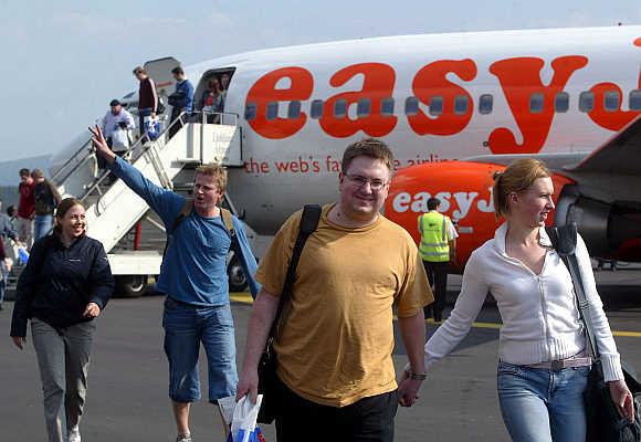 Passengers disembark from easyJet's plane at Ljubljana's airport in Slovenia.