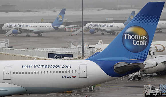 Thomas Cook aircraft at Manchester Airport in England.
