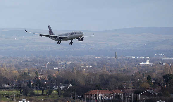 A Qatar Airways aircraft prepares to land at Manchester Airport, England.
