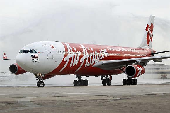 An Airbus A340 AirAsia X budget flight passenger jet arrives at Orly airport near Paris.