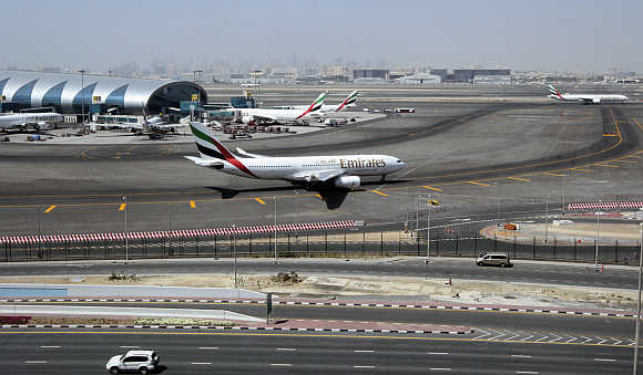 An Emirates Airlines plane taxis on the tarmac at the Dubai International Airport.