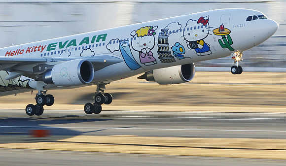 Eva Airways aircraft painted with Hello Kitty characters takes off at Narita international airport in Narita, east of Tokyo.