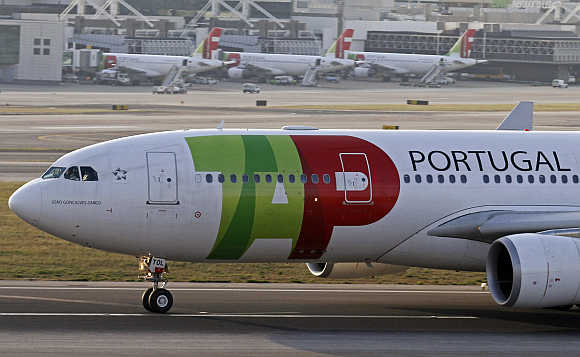 TAP Portugal airlines's Airbus 330 aircraft takes off at Lisbon airport.