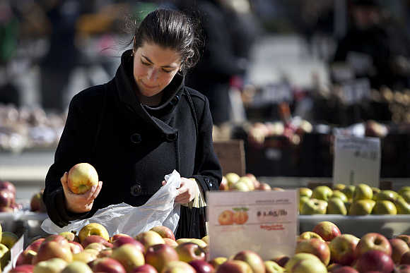 A woman shops for apples at a farmer's market in Union Square in New York.