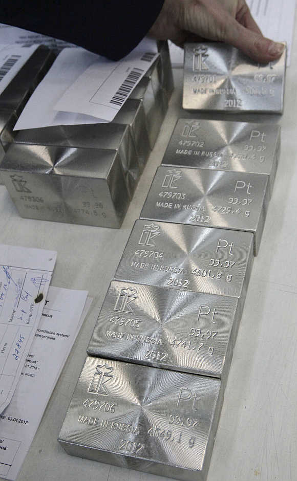 An employee sets out and sorts ingots of 99.97 per cent pure platinum at the Krastsvetmet nonferrous metals plant in Russia's Siberian city of Krasnoyarsk.
