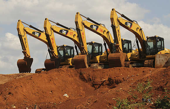 Excavators at a nickel-mining area on the hill of Pomala village in Southeast Sulawesi province, Indonesia.