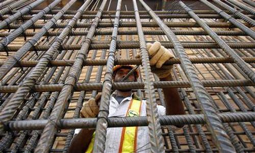 An employee works at a site in New Delhi.