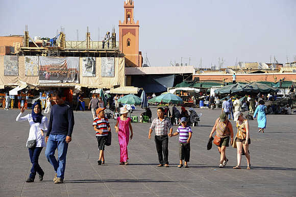Tourists at Marrakesh's Jemma El-Fnaa square.