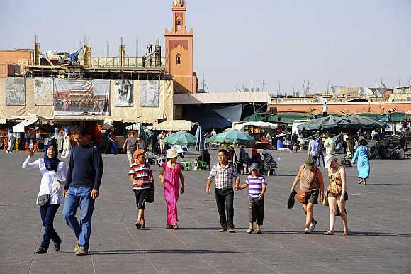 Tourists at Marrakesh's Jemma El-Fnaa square.