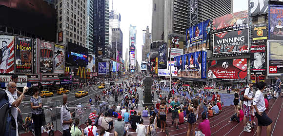 Tourists gather in Times Square, New York.