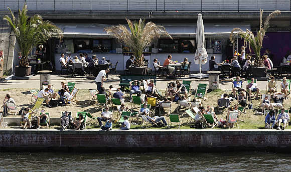 People enjoy a sunny day at River Spree in Berlin's Mitte district.