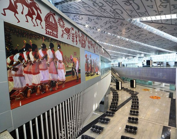 The new Kolkata airport. While the walls are beautified with photographs of traditional folk dances of Bengal, the roof carries lines from Tagore's works.