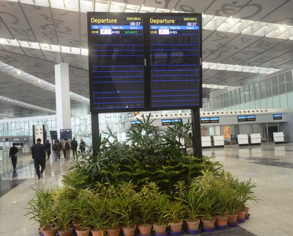 A display board indicates departure schedules of flights at the new Kolkata airport.
