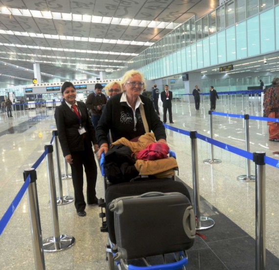 Foreigners check in their luggages at the new Kolkata airport.