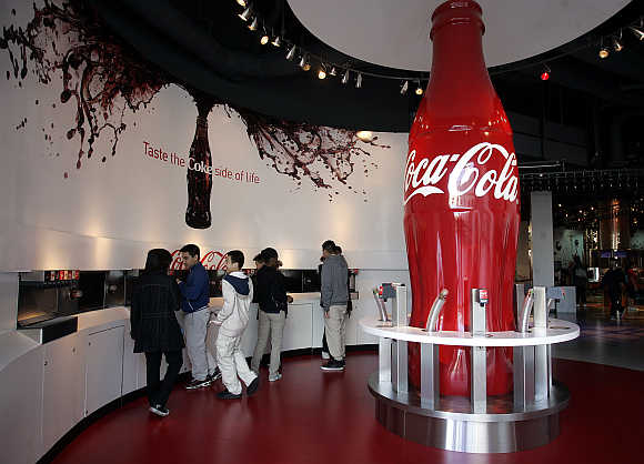 Patrons taste varieties of Coca-Cola at the World of Coca-Cola in Atlanta, Georgia, United States.