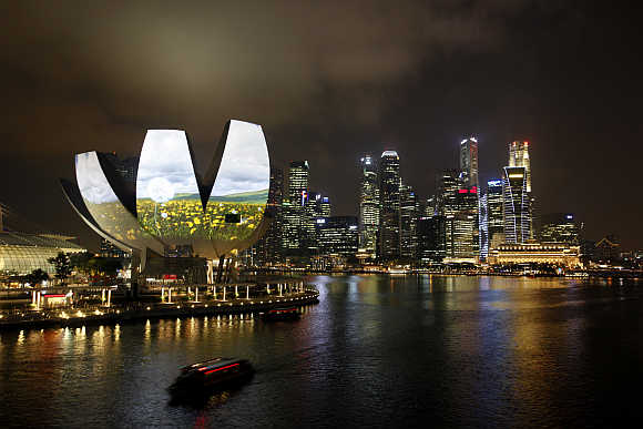 Garden of Light, an animation by Hexogon Solution of Singapore, is projected on the ArtScience Museum during a media preview of the i Light Marina Bay sustainable light art festival in Singapore.
