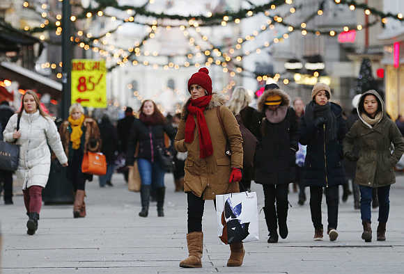 Shoppers walk along Karl Johans Gate, the main shopping street in Oslo, Norway.