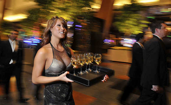 Mariann Lau serves glasses of wine in Las Vegas.