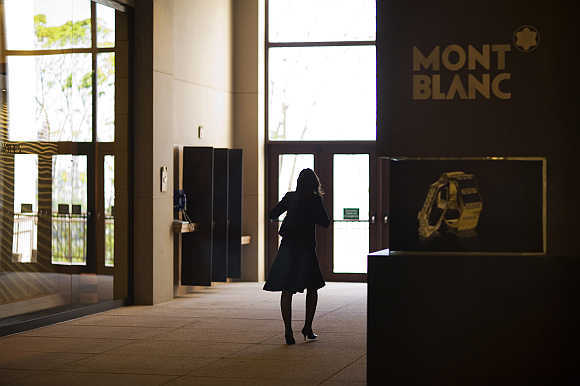 A woman walks next to a Mont Blanc store at Oscar Freire street, Sao Paulo's version of Rodeo Drive in Beverly Hills.