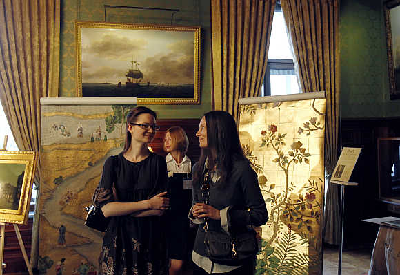 Antique dealers display a selection during a presentation at the British ambassador's residence in Moscow.