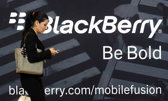 A woman uses her mobile phone at the BlackBerry World Event in Orlando, Florida, United States.
