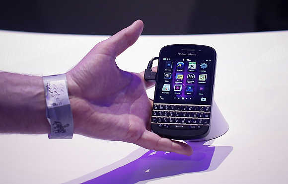 An attendee reaches out to grab a newly launched BlackBerry 10 device in New York.