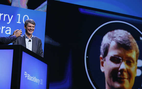 Research in Motion President and CEO Thorsten Heins has his image taken during the launch of the BlackBerry 10 in New York.