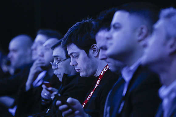 Audience members are tinted by stage lights at the launch of BlackBerry 10 devices in New York.