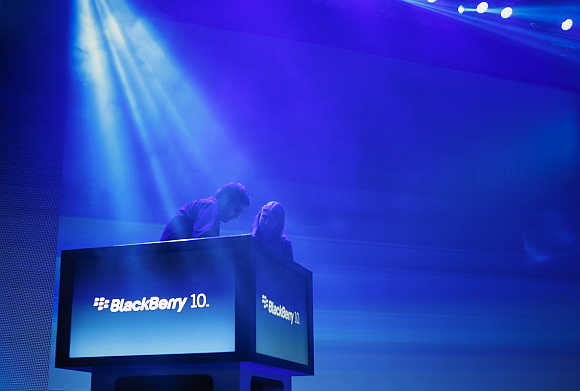 Workers prepare the stage ahead of the launch of BlackBerry 10 devices in New York.