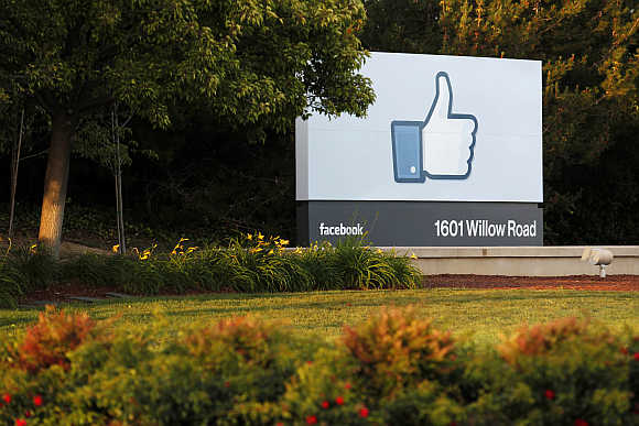 Sun sets on the entrance sign at Facebook's headquarters in Menlo Park, California.