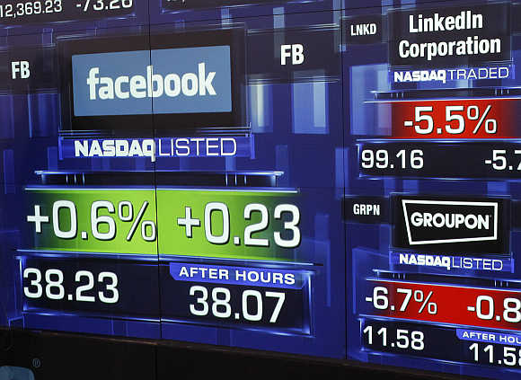 Monitors show the value of the Facebook at the Nasdaq Marketsite in New York.