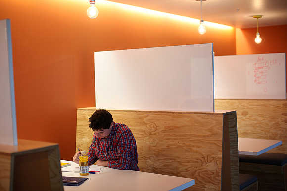 A Facebook employee works in the design studio at the company's headquarters in Menlo Park, California.