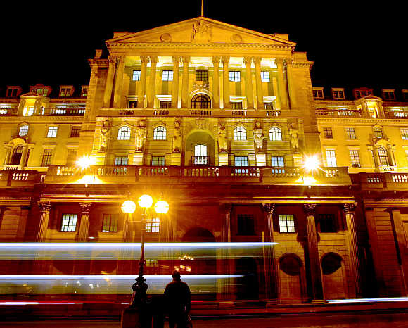 Bank of England is illuminated against the night sky in the City of London.