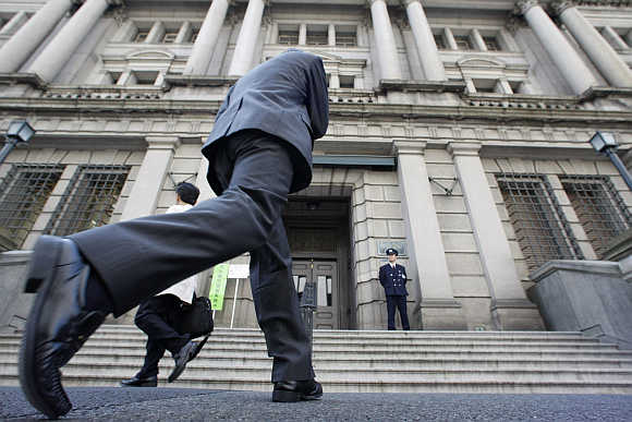 A man walks towards the Bank of Japan building in Tokyo.