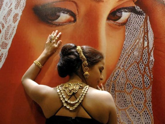 A model displays gold jewellery at a show in the southern Indian city of Hyderabad.
