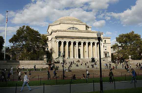 Students walk across the campus of Columbia University in New York.