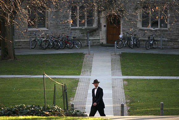 A man walks on the campus of Princeton University in Princeton, New Jersey.